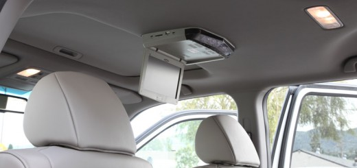 Overhead DVD player installed in a vehicle with sunroof